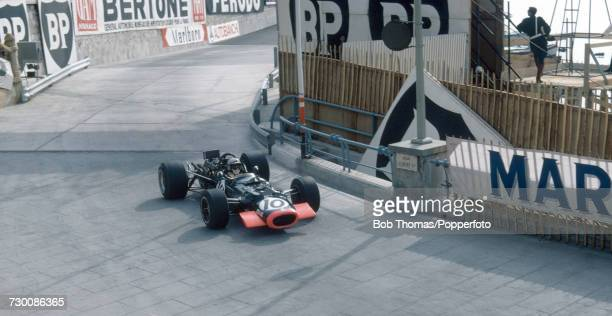Mexican racing driver Pedro Rodriguez drives the Reg Parnell Racing BRM P126 BRM V12 in the 1969 Monaco Grand Prix at the Circuit de Monaco in Monte...