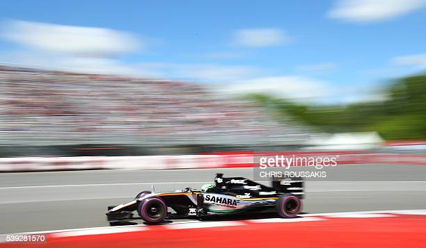 Mexican racing driver Sergio Perez of team Force India passes the grandstands during an afternoon practice session for the Canadian Formula 1 Grand...