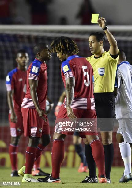 Mexican referee Roberto Garcia Orozco shows the yellow card to Panama's defender Roman Torres during a FIFA World Cup Russia 2018 Concacaf qualifier...