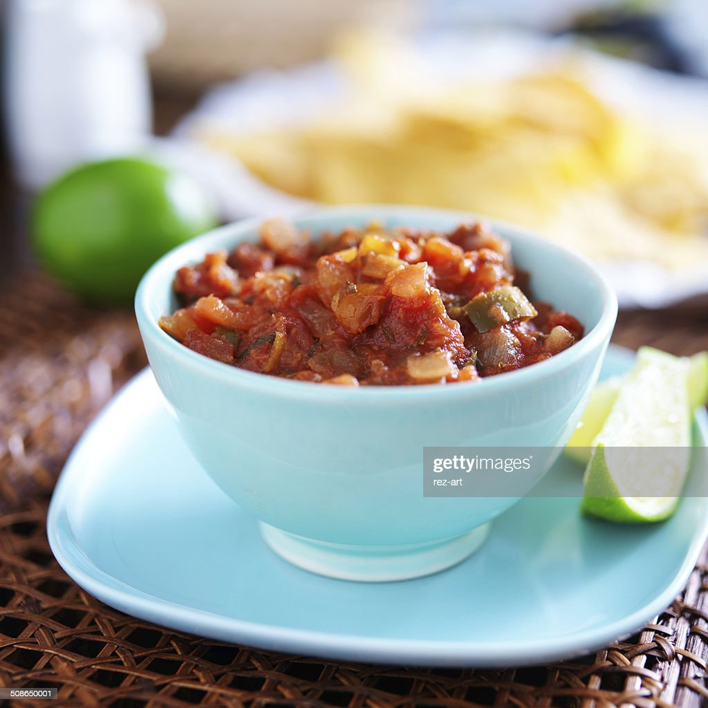 mexican salsa in blue bowl : Stock Photo