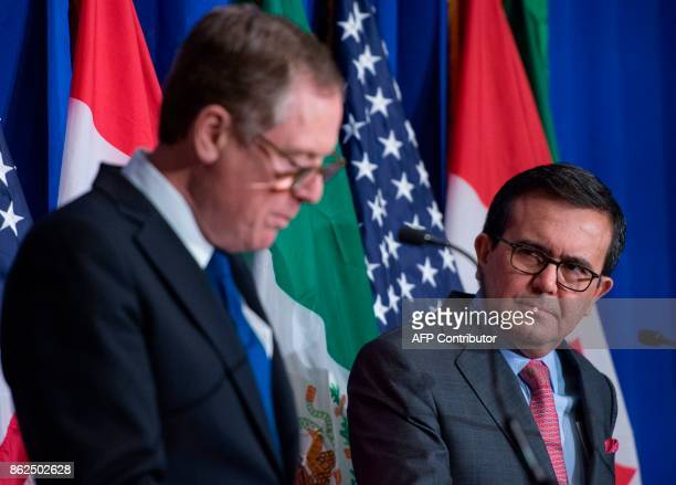 Mexican Secretary of Economy Ildefonso Guajardo Villarreal looks at United States Trade Representative Robert Lighthizer during a press conference at...