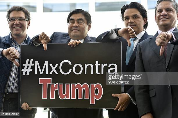 Mexican Senators of leftwing Party of the Democratic Revolution hold a sign with a hashtag against US Republican presidential candidate Donald Trump...