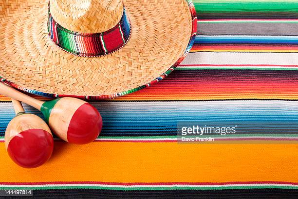Mexican serape rug, sombrero and maracas