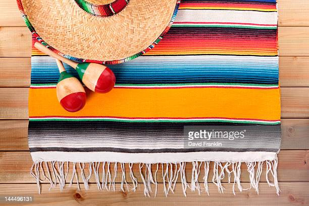 Mexican serape rug with sombrero and maracas