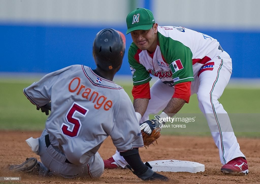 Mexican shortstop Oscar Robles puts out Ruddy Yan of the Dominican Republic at second base at the top of the third inning during the first game of...