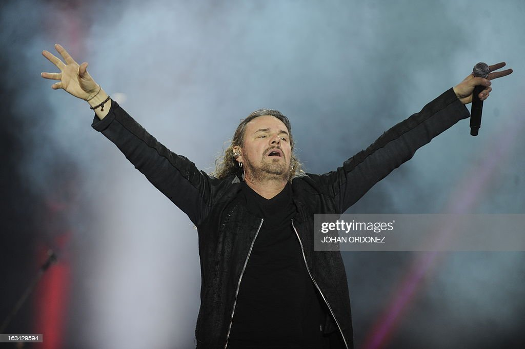 Mexican singer Fernando Olvera of Mana band, performs during the 'Drama y Luz' World Tour at the Mateo Flores stadium in Guatemala City on March 9, 2013. AFP PHOTO/Johan ORDONEZ