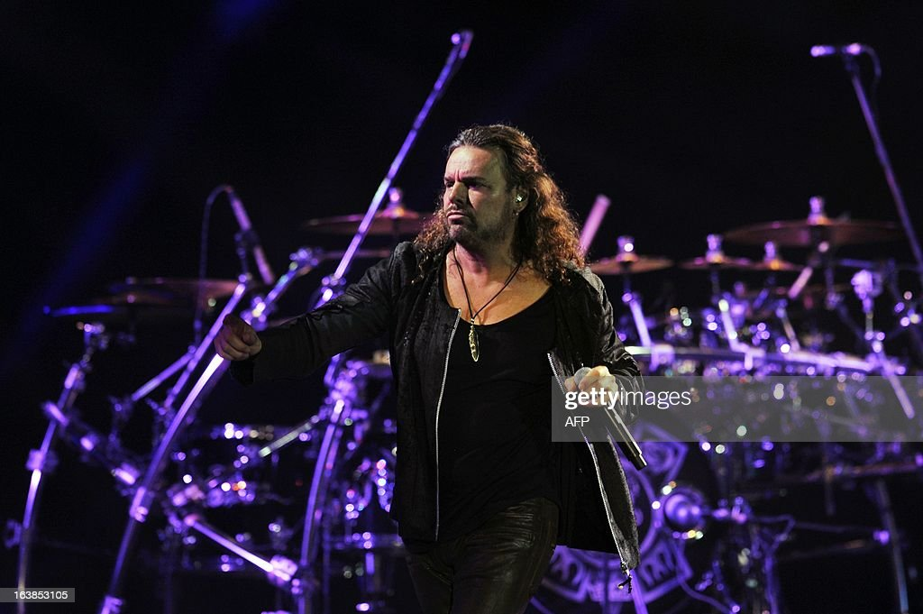Mexican singer Fernando Olvera of the band Mana performs during the 'Drama y Luz' World Tour at the National Footbal Stadium in Managua on March 16, 2013. AFP PHOTO / Hector RETAMAL