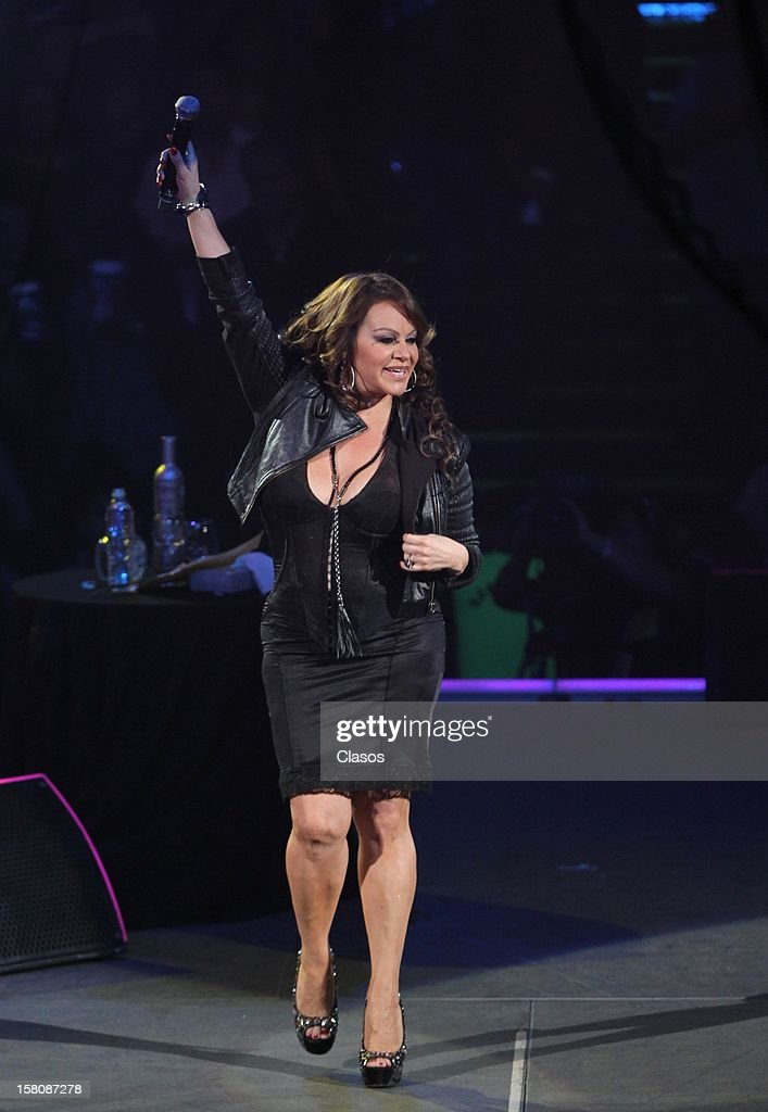 Mexican singer <a gi-track='captionPersonalityLinkClicked' href=/galleries/search?phrase=Jenni+Rivera&family=editorial&specificpeople=666166 ng-click='$event.stopPropagation()'>Jenni Rivera</a> sings during her last concert at the Arena Monterrey on December 08, 2012 in Monterrey, Mexico. Hours after the show the singer was reported missing. The plane where she was traveling with her band crashed on their way to Toluca.