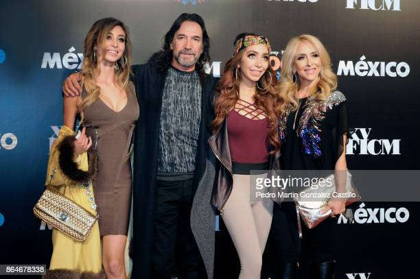 Mexican singer Marco Antonio Solís poses with his family from the red carpet during the DisneyPixar film 'Coco' premiere as part of the Inauguration...