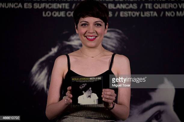 Mexican singer Natalia Lafourcade poses for pictures during a press conference to promote her new album 'Hasta la Ra'íz' on March 17 2015 in Mexico...