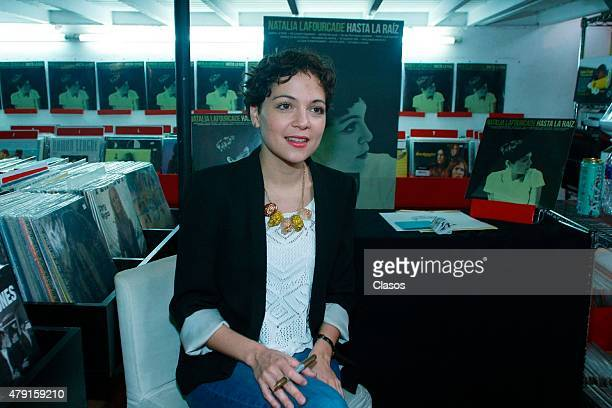 Mexican singer Natalia Lafourcade signs autographs to her fans during a sale of her vynil records on June 30 2015 in Mexico City Mexico