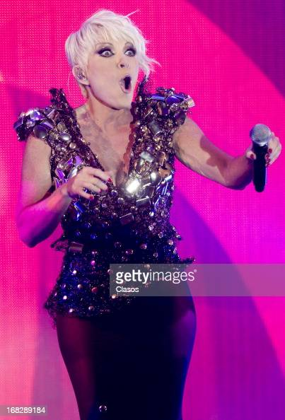 Mexican singer Yuri performs during a Show case and press conference for reaching the gold and platinum disc on May 6 2013 in Mexico City Mexico