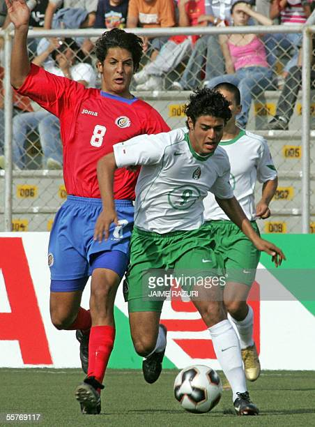 Mexican soccer player Carlos Vela and Costa Rican Celso Borges fight for the ball 25 September 2005 at the Miguel Grau Stadium in Piura Peru during...