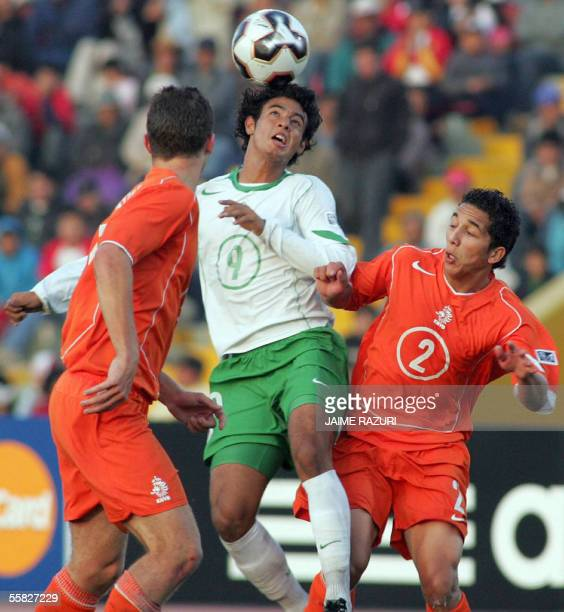 Mexican soccer player Carlos Vela heads the ball between Tom Hairiej and Nicholas Skeverer from Netherland during their U17 World Cup semifinal match...