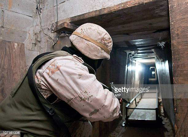 A Mexican soldier patrols a tunnel discovered at a warehouse in Tijuana Baja California state Mexico near the border with the US on November 26 2010...