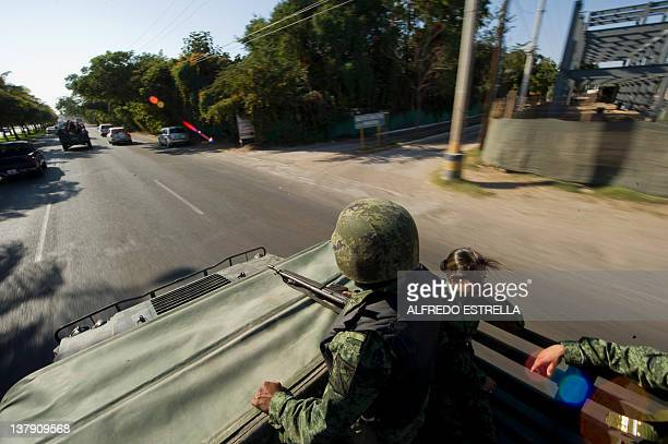 A Mexican soldier patrols the streets of Culiacan Sinaloa State Mexico on a humvee on January 29 2012 More than 40000 people have been killed in...