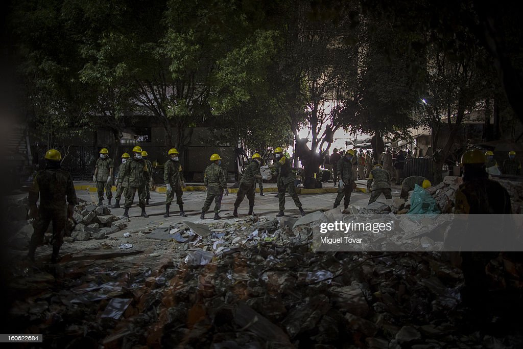 Mexican Soldiers continue Efforts on document retrieval and searching of human bodies in Affected Levels of the administrative building of PEMEX on February 03, 2013 in Mexico City, Mexico. Authorities Investigate That blast killed at least 34 people at at the state-owned companyÕs headquarters in Mexico City.