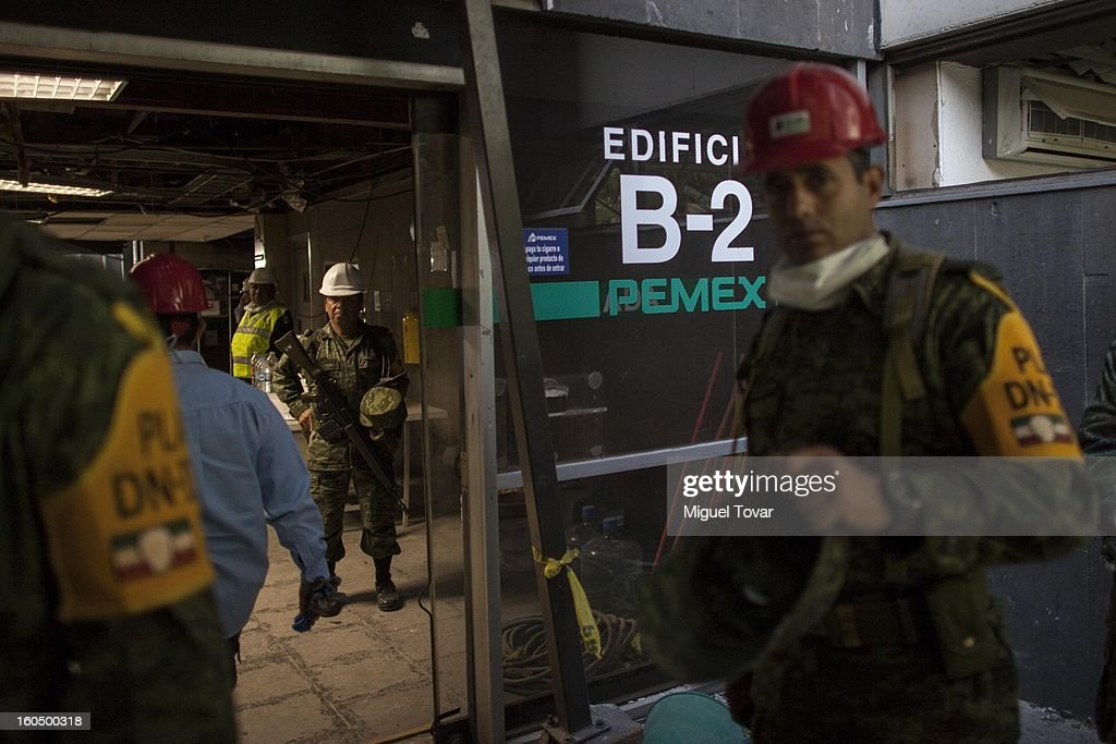 Mexican soldiers inspect the PEMEX administrative building after the explotion on February 01, 2013 in Mexico City, Mexico. Pemex is stepping up security at oil production facilities as authorities investigate a blast that killed at least 33 people at the state-owned company's headquarters in Mexico City.