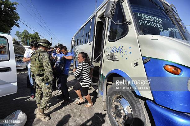 Mexican soldiers inspect vehicles in a checkpoint at the entrance of the Apatzingan community state of Michoacan Mexico on January 12 2015 A deadly...