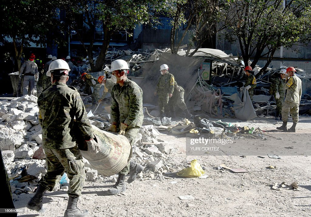 Mexican soldiers remove debris at the building of state-owned Mexican oil giant Pemex, in Mexico City on February 4, 2013. An explosion rocked the skyscraper, last week, leaving up to 36 dead and 121 injured. CORTEZ