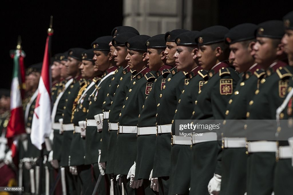 Mexican soldiers stand guard during the welcome ceremony of Canadian Prime Minister Stephen Harper at the National Palace on February 18, 2014 in Mexico City, Mexico. Harper is in Mexico for a Wednesday meeting with the leaders of Mexico and the United States.