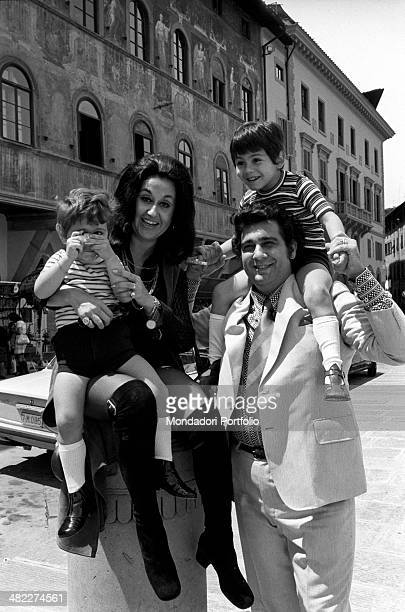 Mexican soprano Marta Ornelas holding her son Alvaro Domingo with a toy camera in the hands in front of Palazzo dell'Antella on piazza Santa Croce...