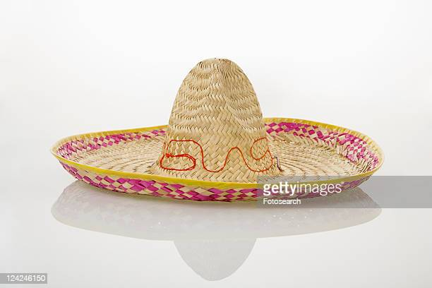 Mexican straw sombrero hat on white background.
