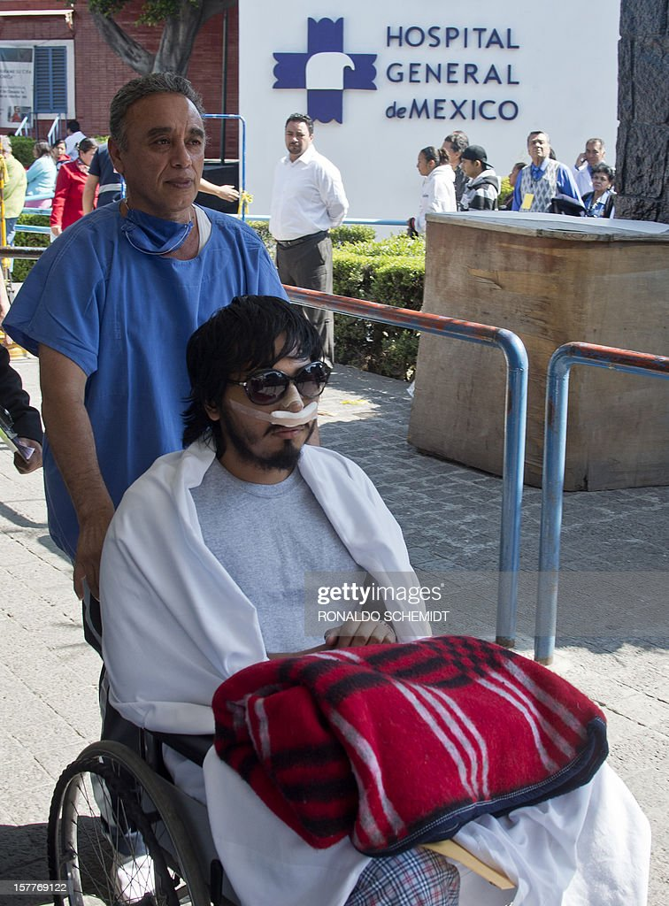 Mexican student Juan Uriel Sandoval is transported on a wheelchair at the General Hospital in Mexico City, on December 6, 2012. Urial Sandoval was injured and lost an eye in the riots that occured during the inauguration of Mexican President Enrique Pena Nieto on December 1. AFP PHOTO/RONALDO SCHEMIDT