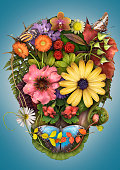 Mexican sugar skull made of flowers and butterflies