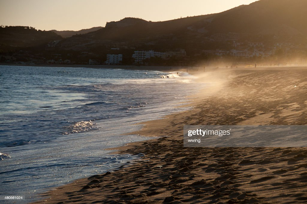 Mexican sunset near Cabo san Lucas with blowing surf : Stock Photo