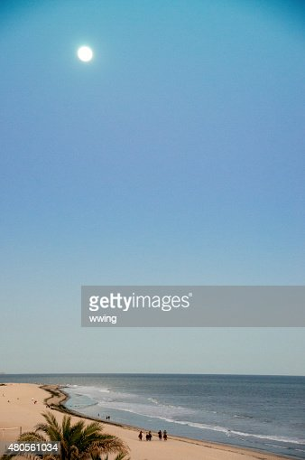 Mexican sunset near Cabo san Lucas with people walking : Stock Photo