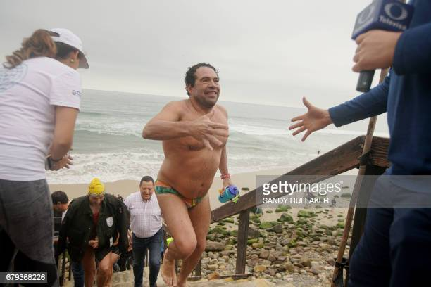 Mexican swimmer Antonio Arguellas greets fans after a 10 kilometer swim which took them across the United StatesMexico border on Friday May 5 2017 in...