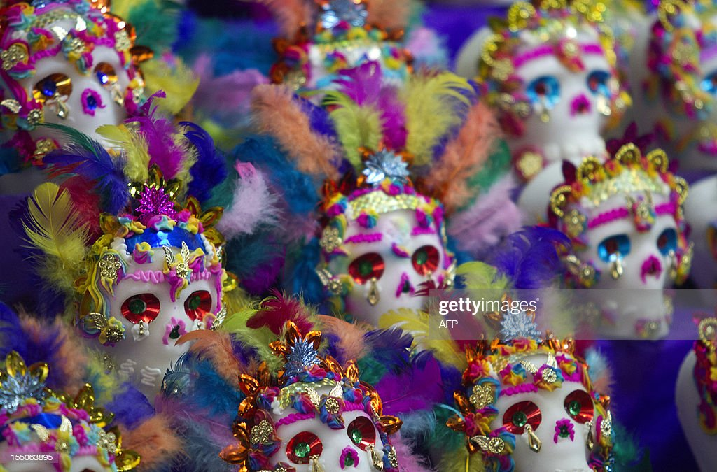 Mexican traditional sugar 'Calaveritas' (Little Skulls) are displayed at the Jamaica market in Mexico City, on October 31, 2012, as Mexicans prepare to celebrate the traditional Day of the Dead. AFP PHOTO/ Pedro Pardo