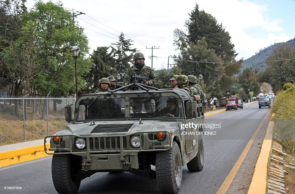 Mexican troops patrol in the vicinity of the place where Pope Francis will officiate an open-air mass in San Cristobal de las Casas, Chiapas State, Mexico on February 13, 2016. ope Francis urged Mexican bishops Saturday to take on drug trafficking with 'prophetic courage,' warning that it represents a moral challenge to society and the church. AFP PHOTO/Johan ORDONEZ / AFP / JOHAN ORDONEZ