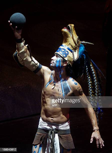A Mexican wears a preHispanic Mayan ball player costume in a recreation at Xcaret Park in Playa del Carmen in Quintana Roo state Mexico on December...