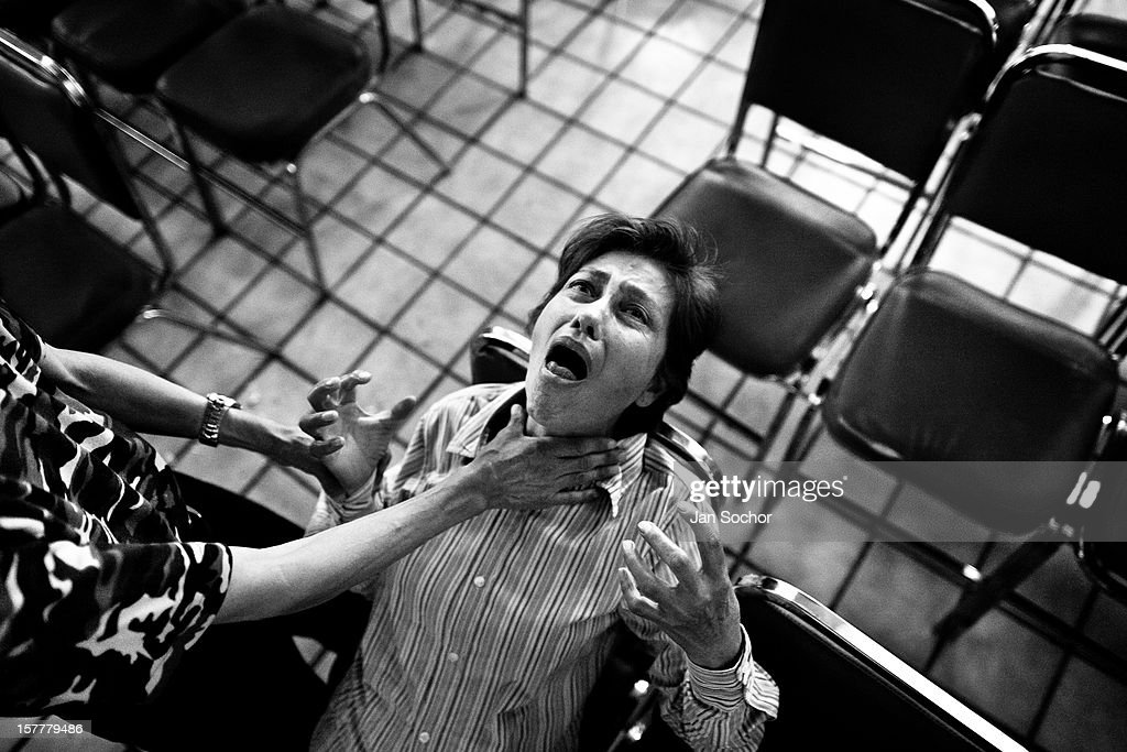 A Mexican woman screams intensively during the exorcism rite practised at the Church of the Divine Saviour in of Mexico City, Mexico, 31 May 2011. Exorcism is an ancient religious technique of evicting spirits, generally called demons or evil, from a person which is believed to be possessed. Although the formal catholic rite of exorcism is rarely seen and must be only conducted by a designated priest, there are many Christian pastors and preachers (known as exorcistas) performing exorcism and prayers of liberation. Using their strong charisma, special skills and religous formulas, they command the evil spirit to depart a victim's mind and body, usually invoking Jesus Christ or God to intervene in favour of a possessed person.