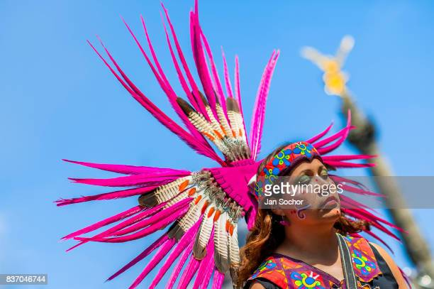 Mexican woman wearing a large feather headgear inspired by Aztecs takes part in the Day of the Dead festivities on October 29 2016 in Mexico City...