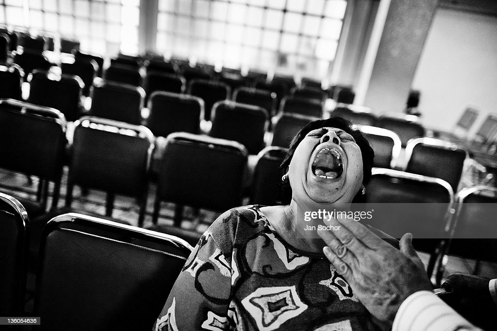 Mexican woman yells desperately during the exorcism rite performed at the Church of the Divine Saviour in of Mexico City Mexico 31 May 2011 Exorcism...