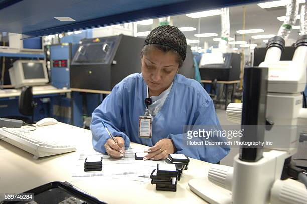 Mexican workers at CyOptics a hightech manufacturing facility across the US border from Brownsville Texas CyOptics a USowned company designs develops...