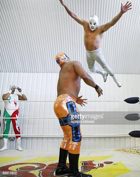 Mexican wrestler El Hijo del Santo dives onto a compatriot during a photocall for Lucha Libre in London on December 4 2008 El Hijo del Santo is...