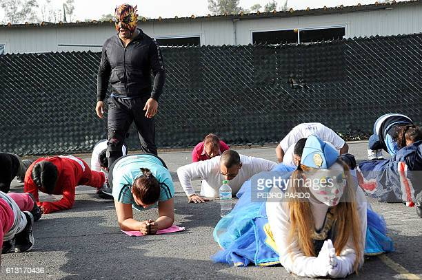 Mexican wrestler Polvora gives instructions while training local police in Iztapalapa neigbourhood in Mexico City to help them subdue suspects...