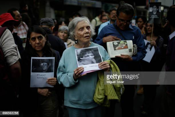 Mexican writer and journalist Elena Poniatowska holds a portrait of the murdered jornalist Regina Martinez during a demonstration to end violence...