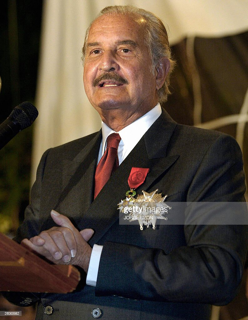 Mexican writer <a gi-track='captionPersonalityLinkClicked' href=/galleries/search?phrase=Carlos+Fuentes&family=editorial&specificpeople=602894 ng-click='$event.stopPropagation()'>Carlos Fuentes</a> delivers a speech after having been decorated by French Ambassador to Mexico, Philippe Faure with the Legion of Honour in the grade of Grand Officer, in Mexico City, 22 October 2003. AFP PHOTO Jorge UZON.