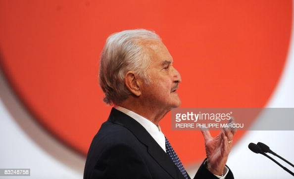 Mexican writer Carlos Fuentes gestures during the 'Don Quijote de La Mancha International Award' ceremony in Toledo on October 13 2008 Spain's King...