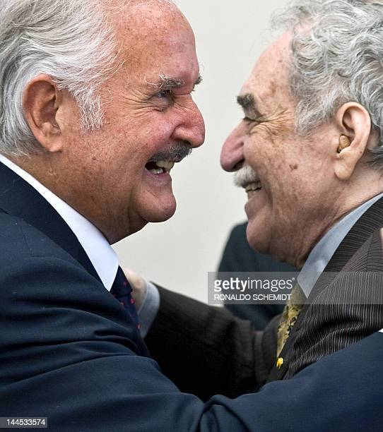 Mexican writer Carlos Fuentes is congratulated by Nobel Prize winner Colombian writer Gabriel Garcia Marquez during a celebration for Fuentes' 80th...