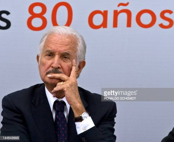 Mexican writer Carlos Fuentes listens to Spanish ex Prime Minister Felipe Gonzalez' s speech during a celebration for Fuentes' 80th birthday in...