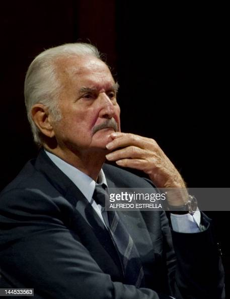 Mexican writer Carlos Fuentes takes part in a tribute to Mexican writer and anthropologist Fernando Benitez at the Fine Arts Palace in Mexico City on...