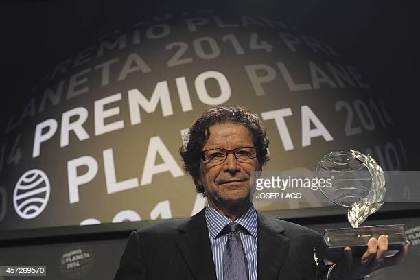 Mexican writer Jorge Zepeda Patterson poses after winning Spain's 2014 Premio Planeta award for his book 'Milena o el femur mas bello del mundo' on...