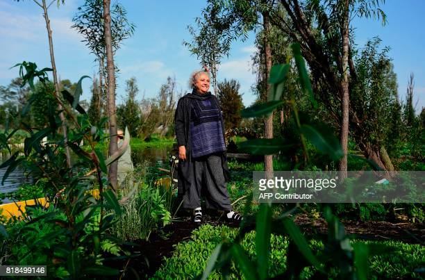 Mexican writer Laura Esquivel poses for pictures during a symposium on biodiversity and gastronomy amid the floating gardens of Xochimilco a UNESCO...