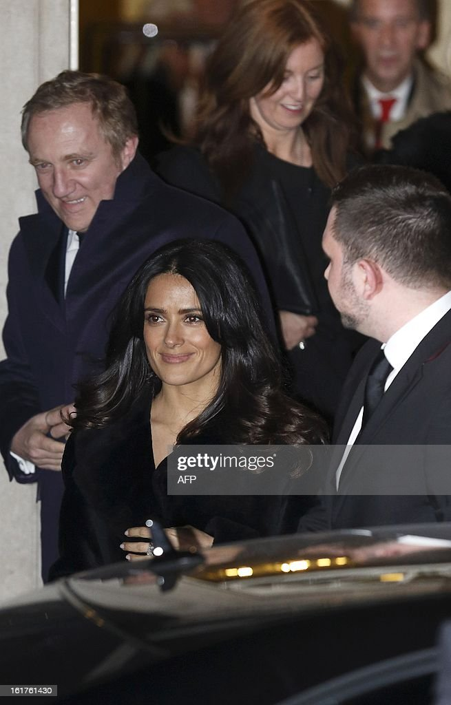 Mexican-American actress Salma Hayek (C) leaves Number 10 Downing Street after attending a reception on the first day of London Fashion Week in London on February 15, 2013. The reception was hosted by Samantha Cameron, the wife of Bristish Prime Minister David Cameron.